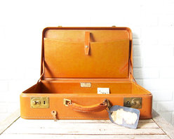 Vintage Caramel Leather Suitcase - This suitcase was used as a photo prop at an outdoor summer wedding! Perfect as an end table, propped up on a vintage luggage rack, or to organize and display small goods.