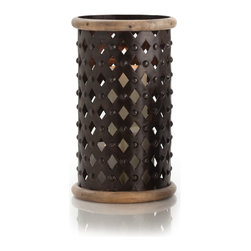 Fallon Large Wood/Iron Hurricane - Weighty, worldly elements bring a look to the tabletop or shelf which is both well-traveled and thoroughly grounded in history. Inspired by a wealth of colonial styles, the Fallon Hurricane surrounds the light of the candle inside or the look of the fillers or stems when used as a vase in a heavy lattice of riveted black iron, an expanse of metalwork between dual rings of softly-weathered wood.
