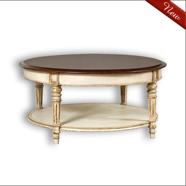 Liz Ann's Interior Design Boutique - The Madaline Cocktail Table has beautiful fluted legs, apron detail, beveled edges and a lower shelf.  Choose from a large selection of gorgeous hand applied finishes.  Shown in Vintage Cream w/Light Walnut Top (two finish colors).  Outside Dimensions: 44Wx21Hx44D.  Pricing is for a one color finish, two finish colors are available at an upcharge.