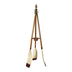 Authentic Models - Oxford Varsity Wooden Standing Coat Rack Brown - FE117 - Shop for Coat Hooks and Racks from Hayneedle.com! The Oxford Varsity Coat Rack makes a quaint and elegant accent for a foyer or living area. It features three varsity oars joined at the top with a rattan basket in the center that's just right for keys or loose change. Crafted of solid wood this rack has a distressed French finish for a weathered an authentic look brass hardware accents and three antiqued brass hooks that are perfect for coats hats or bags. About Authentic ModelsAuthentic Models strives to create and distribute a comprehensive collection of historic and fine art reproductions worldwide. Haring Piebenga founded the company in 1968 and today AM is a European wholesale manufacturer with warehouses and corporate offices in Oregon and Amsterdam. AM pursues original items at auction and uses these models for their design ideas. Each hand-made item appeals to the human need for nostalgia intrigue and beauty by evoking a story from the past. High-quality construction using only the finest materials ensures that these charming pieces will become treasured heirlooms in their own right.