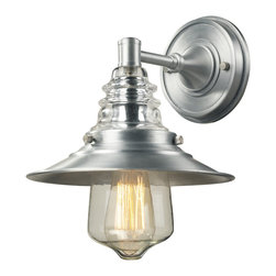 Elk Lighting - EL-66EL-700-1 Insulator Glass 1-Light Outdoor Sconce in Brushed Aluminum - The Insulator Glass Collection was inspired by the glass relics that adorned the top of telegraph lines at the turn of the 20th century.� Acting as the centerpiece of this series is the recognizable shape of the glass insulator, made from thick clear glass that is complimented by solid cast hardware designed with an industrial aesthetic. Finishes include polished chrome, oiled bronze, and weathered zinc.