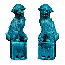"""China Furniture and Arts - Porcelain Blue Foo Dogs - As fantasy lions of Chinese mythology, Foo Dogs always stand in pairs to serve as guardians to prevent harmful things from happening to the family. This pair is painstakingly hand made by skilled craftsmen in China. Great to display on a mantel or side table as a symbolic Asian accent. Each one is 3""""L x5""""W x13""""H."""