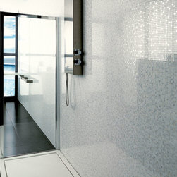 Porcelanosa - This large format tile gives the illusion of an opulent mosaic pattern, but it's rectified edges create a tiny grout joint, giving your wall a seamless finish. No more cleaning endless grout lines in traditional mosaic. It's subtle coloration and finish plays with the lights in your home, for an elegant finish to any wall.