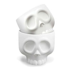 Fred & Friends - Nomskulls Cupcake Molds Set - Nomskulls are ready to fill with your favorite grey batter and bake into perfect cupcake craniums. One bite and you'll be head over heels, because there's no doubt about it - this skull bone's connected to the yum bone! We've packed four silicone skull molds in each printed giftbox.