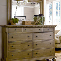 Universal Furniture - Paula Deen Drawer Dresser with Mirror - Add a little southern charm to your bedroom by including the Paula Deen Drawer Chest and Mirror Set from Universal Furniture. The landscape mirror and functional six drawer chest come with a sliding jewelry tray, bottom cedar drawers, and a convenient pull-out clothing rod, all of which add a touch of country-chic to your bedroom decor. This gorgeous pair is soaked in a rich oatmeal finish and styled with corresponding molding that is sure to create a timeless look in any Southern-style bedroom.