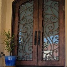 by Universal Iron Doors & Hardware Inc.