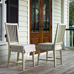 Universal Furniture International Inc - Paula Deen River House Kitchen Side Chair - River Boat - Set of 2 Multicolor - U - Shop for Dining Chairs from Hayneedle.com! Brighten your space with the casual country charm of the Paula Deen River House Kitchen Side Chair - River Boat Set of 2 in white with hints of gray rub-through. These tastefully aged chairs are great for the breakfast nook or casual dining table. Both feature a simple slat-back design and contoured saddle seat with removable cushioned seat accented with a decorative apron.About Paula Deen HomeBring comfort home with the only collection of furniture inspired by the way Paula Deen relaxes in her own Savannah abode. These pieces all showcase an inviting country style that captures the beauty history and hospitality of life in rural Georgia. Not only do these furnishings offer a graceful elegance but they are assembled to the highest quality to really stand the test of time with features such as solid hardwood frames dovetail joints drawers that glide easily and a clean consistent finish that withstands the wear and tear of daily use. Paula Deen Home partners with Universal a company recognized as a leader in exceptionally crafted furniture and bedroom dining room and occasional products as well as entertainment centers home office selections and wall units.