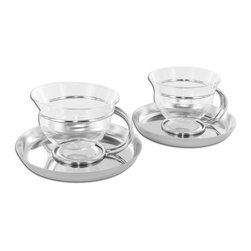 Mono - Filio Collection Set of 2 Glass Teacups with Stainless Steel Saucers - The case of the mysterious levitating teacups? With a little detective work, it's clear to see that these curvaceous glass Filio teacups are held aloft by slyly-crafted metal stands made to perch atop coordinating saucers. Mystery solved.