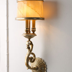 """Bancroft"" Wall Sconce - Handcrafted of steel, the ""Bancroft"" Wall sconce features a hand-blown café au lait with a ribbed glass shade and decorative finial.  No detail has been missed in the design of this lovely sconce.    * Oxidized silver-leaf finish with gold and bronze highlights.    * 9""W x 7.5""D x 23.4""T."