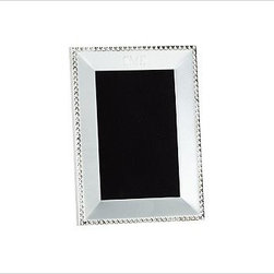 "Beaded Silver-Plated Picture Frame, 4 x 6"" - Gleaming beads edge the polished planes of our silver-plated frames. They make an excellent showcase for black and white photos. Backed with black velvet. Sealed with lacquer to protect the finish. Designed to display vertically or horizontally on a tabletop. Larger frames are sold individually. The mini frames are available as a set of 3 that includes one of each: square, rectangle and round. Monogramming is available at an additional charge. Monogram will be centered above the photo opening. Frame sits vertically when personalized. Watch a video about creating a {{link path='/stylehouse/videos/videos/dt_v4_rel.html?cm_sp=Video_PIP-_-DESIGN_TIPS-_-NEW_FAMILY_WALL' class='popup' width='950' height='300'}}family photo gallery{{/link}}."