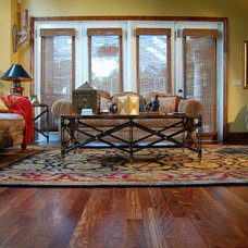 Tropical Living Room by Through the Woods Fine Wood Floors, Inc.