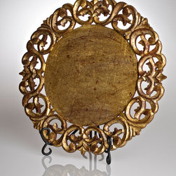 Vendome Round Placemat -Gold Leaf - The rich flourishes of an intricate cut bring regal style to a traditional dining table, ensuring that your first layer of detail is also your most irreproachably fine.  The Vendome Round Placemat is surrounded by a deep border of lacy wrought-iron designs to create a grand depth of texture, while its opulent finish of antiqued gold leaf makes it an instantly treasured addition to the table setting.