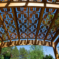 Parasoleil patterns - looking underneath an all-weather patio shade for outdoor entertaining