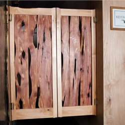 Rustic Saloon Doors - These beautiful saloon doors work as a great room divider in your home or at a bar. They sure do have holes, but not from a Wild West gunfight. Highly customizable, these saloon doors will become a great conversation starter.