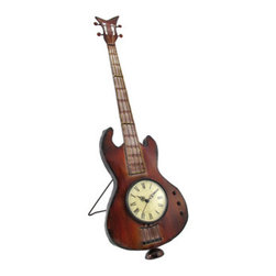 Metal Guitar Tabletop Clock 28 In. - This rockin` tabletop clock is shaped like a guitar, and is sure to be admired! Made of metal, this piece measures 28 inches tall, 8 1/2 inches wide, and opens up to 10 inches deep. It has a built in easel type stand, and is hand painted. The clock features quartz movement, with the face measuring approximately 4 1/2 inches in diameter. The cream colored clock has black Roman numerals and decorative hands to mark the time, and it runs on 1 AA battery (not included). This clock makes a wonderful gift for your favorite musician, and adds a fun accent to any home.