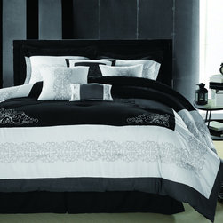 None - Florence Black/White 8-piece Oversized King-size Comforter Set - The Florence comforter set features a scroll embroidery design and classic diamond quilting in the center of the comforter. The set is made of coordinating colors of black and white for a fabulous look.