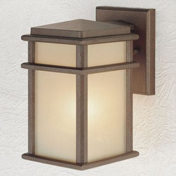 Murray Feiss Mission Lodge Outdoor Wall Lantern - 9.25H in. Corinthian Bronze - With its modern look the Murray Feiss Mission Lodge Outdoor Wall Lantern can be placed near the garage door a front entry or a covered patio. This light features a Corinthian bronze finish and amber ribbed-glass shades. For ample outdoor lighting use one 100-watt E bulb. Clean the fixture with a damp cloth and mild soapy water and the shades with household glass cleaner. This light measures 9.25H x 5.25W x 7D inches.About Murray Feiss LightingThree generations have built Murray Feiss as a renowned name in lighting and it now stands as a leader with a reputation for impeccable craftsmanship innovative design and honest value. Murray Feiss prides itself as the foremost designer and manufacturer of interior and exterior lighting and home decor in the lighting industry. Over 3 800 skilled artists and technicians bring Murray Feiss designs to life meticulously finishing and quality-testing each exclusive product. Murray Feiss Lighting has expanded its extensive copyrighted line of products to include grand chandeliers casual fixtures vanity bath lights with coordinated bath hardware outdoor lighting lamps torchieres wall brackets mirrors and decorative accessories. Whether outdoor or in lighting from Murray Feiss means high quality and innovation.