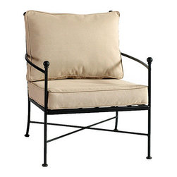 Ballard Designs - Castellon Lounge Chair - Sand colored box edge cushion included. Charcoal finish. Fully assembled. Replacement cushions available. Castellon Lounge Chair requires 1 replacement cushion set.. Use of an outdoor furniture cover is recommended to extend the life of your piece. The simple, sculptural lines and timeless details of our Castellon Outdoor Lounge Chair whisper relaxation with effortless style. Wrought iron frame is fully welded for enduring strength and powder-coated to resist moisture, chipping and rust. Castellon Lounge Chair features: . . . . . Made in USA.