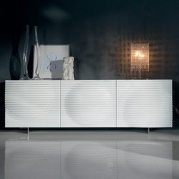 Cattelan Italia - Cattelan Italia | Luna Credenza - Made in Italy by Cattelan Italia.Obtain the best with the Luna Credenza, which is at the forefront of trends and innovations. Crafted from a lacquered wood frame, its dramatic ribbed doors with three dimensional circle patters are fabricated from polyurethane. A stainless steel base grounds the furnishing, which will stand the test of time. Select from a variety of size and color combinations to customize this modern piece to your exact design needs. Choose between two, three and four doors to store and display all your accessories with the up-most modern style.