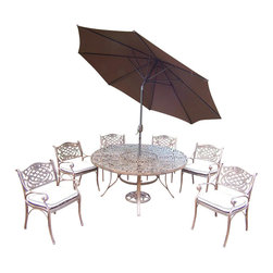 Oakland Living - 9-Pc Round Patio Dining Set - Includes one round table, six dining chairs with cushions, tilting umbrella and stand. Metal hardware. Umbrella hole. Fade, chip and crack resistant. Center of table can be replaced with ice bucket. Traditional lattice pattern and scroll work. Warranty: One year limited. Made from rust free cast aluminum. Antique bronze hardened powder coat finish. Minimal assembly required. Chair: 23 in. W x 21.5 in. D x 34 in. H (27 lbs.). Table: 60 in. Dia. x 29 in. H (70 lbs.)This 60 inch 9 piece dining set is the prefect piece for any outdoor dinner setting. Just the right size for any backyard or patio. The Oakland Mississippi Collection combines southern style and modern designs giving you a rich addition to any outdoor setting. Each piece is hand cast and finished for the highest quality possible.