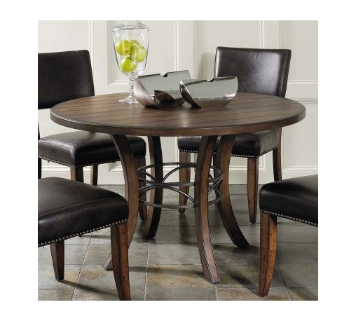 Hillsdale Cameron 5 Piece Round Wood Dining Table Set with Parson Chairs - The Hillsdale Cameron 5 pc. Round Wood Dining Table Set with Parson Chairs provides comfortable dinner seating and a beautiful contemporary style for your dining room. Featuring a sturdy wood construction this dining table has a dark gray metal accent in the base. The chairs are upholstered in dark brown faux leather with a decorative nail head trim. This dining set seats up to four people comfortably. About Hillsdale FurnitureLocated in Louisville Ky. Hillsdale Furniture is a leader in top-quality affordable bedroom furniture. Since 1994 Hillsdale has combined the talents of nationally recognized designers and globally accredited factories to bring you furniture styling and design from around the globe. Hillsdale combines the best in finishes materials and designs to bring both beauty and value with every piece. The combination of top-quality metal wood stone and leather has given Hillsdale the reputation for leading-edge styling and concepts.