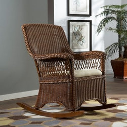 Hospitality Rattan Wicker Indoor Rocking Chair with Cushion - TC Antique - We've loved the classic rocker for years, and the Hospitality Rattan Wicker Indoor Rocking Chair with Cushion - TC Antique is built for many more years of loving attention. This durable rocker is crafted from high-quality rattan with hand-woven wicker and solid wood rocking surfaces. An antique finish gives it a rich visual style, and the plump cushion combines its comfort with the curved arms and high back for a first-rate rocking experience. The soft cushion has a neutral fabric.About Hospitality RattanHospitality Rattan has been a leading manufacturer and distributor of contract quality rattan, wicker, and bamboo furnishings since 2000. The company's product lines have become dominant in the Casual Rattan, Wicker, and Outdoor Markets because of their quality construction, variety, and attractive design. Designed for buyers who appreciate upscale furniture with a tropical feel, Hospitality Rattan offers a range of indoor and outdoor collections featuring all-aluminum frames woven with Viro or Rehau synthetic wicker fiber that will not fade or crack when subjected to the elements. Hospitality Rattan furniture is manufactured to hospitality specifications and quality standards, which exceed the standards for residential use.Hospitality Rattan's Environmental CommitmentHospitality Rattan is continually looking for ways to limit their impact on the environment and is always trying to use the most environmentally friendly manufacturing techniques and materials possible. The company manufactures the highest quality furniture following sound and responsible environmental policies, with minimal impact on natural resources. Hospitality Rattan is also committed to achieving environmental best practices throughout its activity whenever this is practical and takes responsibility for the development and implementation of environmental best practices throughout all operations. Hospitality Rattan maintain