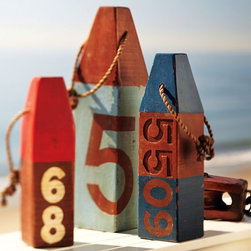 Wooden Buoy - These will work as a quirky table centerpiece.