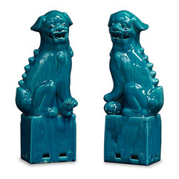 """China Furniture and Arts - Porcelain Large Blue Foo Dogs - As fantasy lions of Chinese mythology, Foo Dogs always stand in pairs to serve as guardians to prevent harmful things from happening to the family. This pair is painstakingly hand made by skilled craftsmen in China. Presented in a lustrous blue tone, they are great to display on a mantel or side table as a symbolic Asian accent. Each one is 7""""W x 5""""D x 17.25""""H."""
