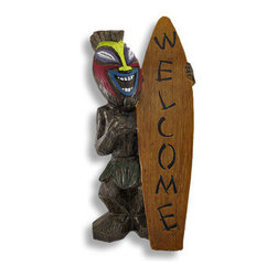 Friki Tiki Surfer Tikiette Welcome Statue 18 in. - Welcome friends and make new ones with this unique welcome sign! Carved and cast from resin, this tropical tikiette surfer will put your guests at ease with his laid-back style and colorful face. A friendly addition to your porch, patio or front steps. This tiki guy measures 18 inches tall, 10 inches wide and 7 inches deep.