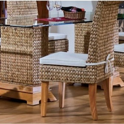 "Hospitality Rattan Sea Breeze Indoor Seagrass 42 x 72 in. Pedestal Dining Table - The wide, organic design of the Hospitality Rattan Sea Breeze Indoor Seagrass 42 x 72 in. Pedestal Dining Table with Beveled Glass - Natural is just at home in your beach house, loft apartment or bungalow anywhere between the coasts. Two wooden frames with feet of solid and naturally finished hardwood are wrapped in hand-woven seagrass. Each pedestal base helps support a wide sheet of tempered and beveled glass that creates a table that can comfortably seat six people who are about to be very impressed.About Hospitality Rattan Hospitality Rattan has been a leading manufacturer and distributor of contract quality rattan, wicker, and bamboo furnishings since 2000. The company's product lines have become dominant in the Casual Rattan, Wicker, and Outdoor Markets because of their quality construction, variety, and attractive design. Designed for buyers who appreciate upscale furniture with a tropical feel, Hospitality Rattan offers a range of indoor and outdoor collections featuring all-aluminum frames woven with Viro or Rehau synthetic wicker fiber that will not fade or crack when subjected to the elements. Hospitality Rattan furniture is manufactured to hospitality specifications and quality standards, which exceed the standards for residential use. Hospitality Rattan's Environmental Commitment Hospitality Rattan is continually looking for ways to limit their impact on the environment and is always trying to use the most environmentally friendly manufacturing techniques and materials possible. The company manufactures the highest quality furniture following sound and responsible environmental policies, with minimal impact on natural resources. Hospitality Rattan is also committed to achieving environmental best practices throughout its activity whenever this is practical and takes responsibility for the development and implementation of environmental best practices throughout all operations. Hospitality Rattan maintains a policy of continuous environmental improvement and therefore is a continuing work in progress. Hospitality Rattan's Environmentally Friendly Manufacturing Process All of Hospitality Rattan products are green. From its basic raw materials of rattan poles, peels, leather, bamboo, abaca, lampacanay, wood, leather strips, and boards, down to other materials like nails, staples, water-based adhesives, finishes, stains, glazes and packing materials, all have minimum impact to the environment and are safe, biodegradable, recycled, and mostly recyclable. Aside from this, the products have undergone an environmentally-friendly process that makes them """"greener."""" The company's rattan components are sourced from sustained-yield managed forests, which means the methods used to grow and harvest the rattan vines ensure the long-term life of the forest and protect the biodiversity of the forest's ecosystems. Hospitality Rattan is committed to buying and using all materials, from rattan and hardwood to finishing materials, from reputable and renewable suppliers and seeks appropriate evidence that suppliers are in compliance with this policy. Hospitality Rattan strives to use materials that are processed in an environmentally responsible manner, or consist of a high level of recycled material. Finishing materials and stains used in Hospitality Rattan's furniture products consist of 75% water-based solutions which evaporate upon application with reduced or Volatile Organic Compounds (VOCs). The furniture factories use water-based glues, stains, topcoats and other finishes on all of their products. The switch from traditional solvent-based processes to water-based processes involved consolidating several processes by the factories, resulting in an 85% reduction in VOC emissions."