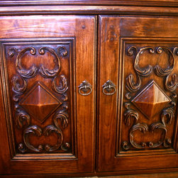 Bathroom Vanity - Spanish style - Bathroom vanity cabinets. Hand carved in Solid Butternut with aniline dye and glazing to darken the wood.