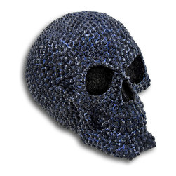 Skullplanet - Sapphire Blue Finished Gemstone Skull Statue Human Bling - This wickedly awesome human skull figure / statue looks like it`s covered with brilliant sapphires. Made of cold cast resin, the statue has hundreds of faceted bumps that look like gemstones, and is finished in a midnight blue enamel to make the `stones` come to life. It stands 5 inches tall, is 6 inches deep, and 4 1/2 inches wide. It makes a great gift for any skull lover.