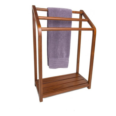 "Aqua Teak - Versatile Teak Towel Rack - From the Spa Collection - This gorgeous teak towel stand or teak pool rack was handcrafted in Indonesia. Handcrafted from sustainably harvested and environmentally friendly teak wood, this versatile teak towel rack includes a convenient lower shelf for additional storage. This teak shower rack includes all stainless steel hardware for long lasting stability. Stained with teak oil and sealed with a water based sealant, the teak towel rack is both beautiful and built to last! We are so confident that you will love your teak towel stand that we offer a 30 day satisfaction guarantee and 5 year warranty on all of our products. (Some assembly required) Dimensions: 22.5""w x 34""h x 11.25""d"