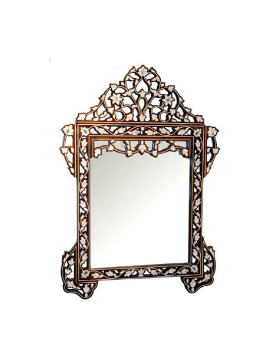 Middle Eastern Artisans - Walnut Shell Mirror - Transform your bedroom, bathroom or entryway with this statement mirror. The carved walnut, mother-of-pearl and abalone details add artistic beauty to this functional piece. Hang it on a boldly painted wall, and the look gets even stronger as the paint peeks through each curve.