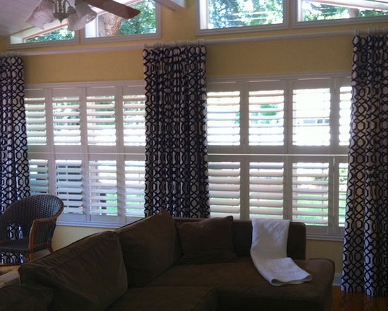 """Casual Flat Panels - Flat panels on a rod with rings will achieve privacy and light control, while not looking """"fussy"""" or """"old fashioned"""".  Design by Calico Home.  Installation by Curtain Pros."""