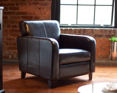 Ease back and relax in the Maxon Club Chair. The cool post-Depression era design modern armchairs