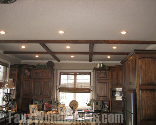 Faux Timber Beams - Faux wood beams in a timber finish create a crisscross ceiling beam pattern to decorate this kitchen and match the wood cabinets.