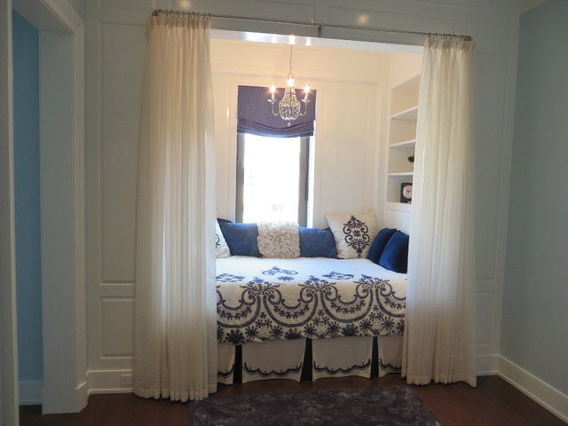 Blue And White Bedroom Nook With A Roman Shade And Sheers