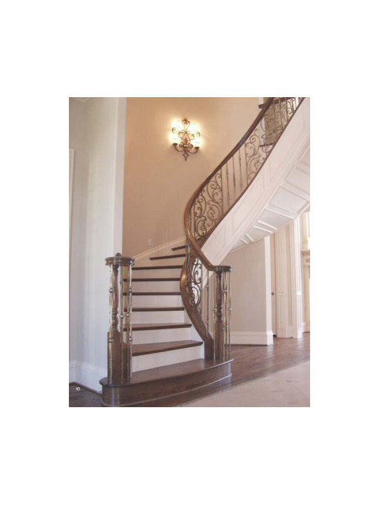 Home Stair Remodel - This custom stair remodel features gothic series wrought iron balusters and tuscany panels. CheapStairParts.com