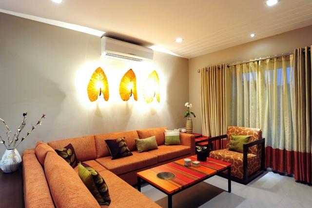 Model apartment tropical living room other metro for Room design mahim