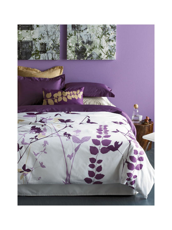 """Amanda Purple Duvet Set - Our Amanda duvet covers interpret botanical motifs in modern graphic silhouettes. Entwined reeds, vines and tall flowers appear in purple and taupe tones—on a crisp white background of 300 thread count cotton sateen. Set includes duvet cover and two solid-color pillow shams with 2"""" flange detail. Duvet cover reverses to solid purple. Also available in green colorway."""
