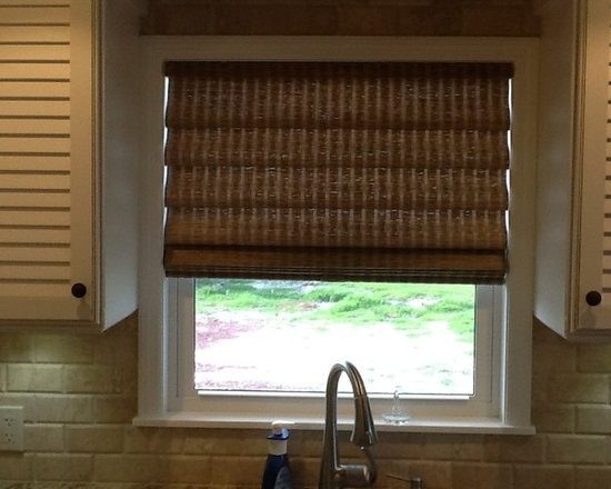 Blinds & Shades - Woven wood Roman Shade adds a touch of informal softness to this kitchen window.