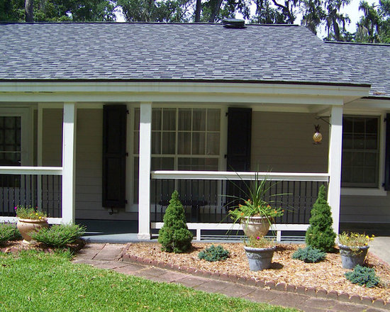 Home Renovation in Beaufort, SC - Porch shot with functional, bi-fold shutters for mild storm protection from Timberlane.