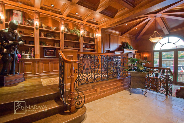 Wood paneled library and office traditional home