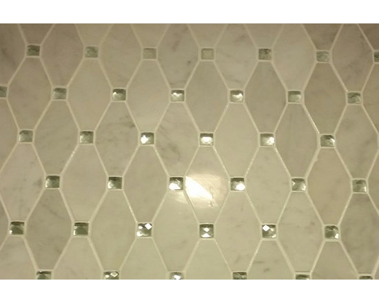 marble and glass - This is such a beautiful and unique shaped mosaic. The glass has an elegant sparkle when light hits it plus white marble. This makes for such an elegant and timeless accent/border.