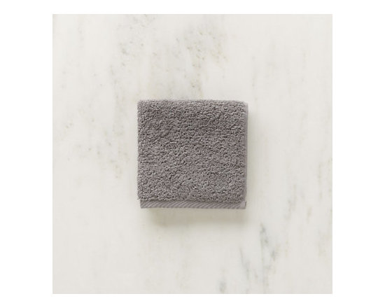 Grandin Road - Micro Cotton Wash Cloth - Soft, super absorbent and quick-drying MicroCotton towels and matching towel-style bath mat. Made from 100% long staple, very fine cotton. Rated the best cotton towel in America by Real Simple magazine. Fiber length and density allow towels and mats to absorb moisture 250% faster than a regular cotton towel. 600 GSM weight. Extra absorbent and rated the best cotton towel in America by Real Simple magazine, MicroCotton towels make a great addition to the master or guest bath. Each size is sold individually and made from exceptionally soft, silk-like, 100% long-staple cotton fibers that weigh in at 600 grams per square meter. Each cotton fiber is very fine and longer than those used in some of the finest Egyptian cottons: each loop is made up of 120 fibers, whereas regular cotton towel loops are made of 30 to 40 yarns. Each size is available in a wonderful array of hues; the color selection coordinates perfectly with the Reversible Cotton Bath Rug.. . . . . Machine washable: wash dark colors separately in cool water (40 degreesF), do not use bleach or products containing benzoyl peroxide. Towel-style bath mat does not have a rubber backing. Each piece sold separately. Imported.