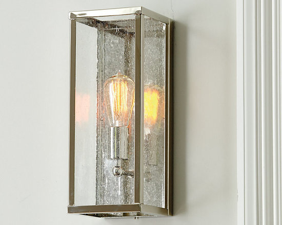 Ballard Designs - Emily 1-Light Sconce - Pair with our Vintage Light Bulbs LI059 (sold separately). Perfect for entryway or dining room. Use in pairs for greater impact. A minimalist look that suits any decor. The polished nickel steel frame with clear seeded glass panes puts the single bulb housed inside on display. Seeded glass softens the light for a flattering glow.Emily 1-Light Sconce features: . . .