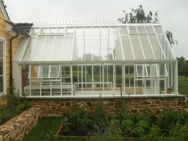English Greenhouse - Victorian Glasshouse attached to home traditional-greenhouses