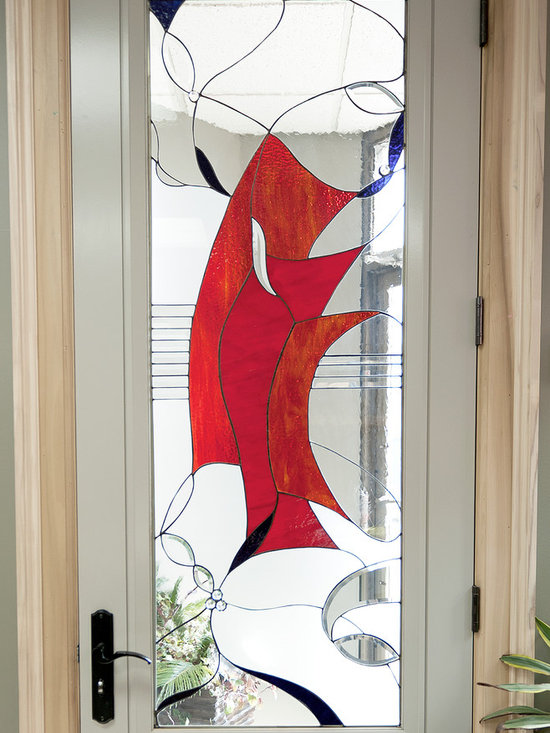 Glass Door Inserts. - This was the first project specifically designed and built for my new studio space. The  technique is copper foil using many types of glass in this project including GNA, Acid Etch, Uroborus Red, and a Bullseye Purple.... and of course some bevels. Glassworks Studio, Studio Entry 2012