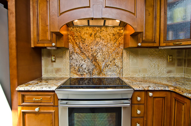 Revelation Bordeaux Granite: Full backplash behind the ...
